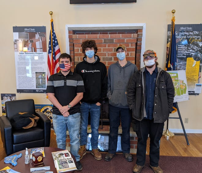Pictured are four of the five Alfred State students whose actions led to the rescue of a man from the icy Genesee River in Wellsville on Friday, Feb. 12. From left to right are Jack Derby, motorsports technology, Patchogue; Alex Tanevski, electrical construction and maintenance electrician, Buffalo; Owen Brewster, motorsports technology, Hamburg; and David Snyder, heavy equipment: truck and diesel technician, Manlius. Not pictured is Kameron Mills, a heavy equipment: truck and diesel technician student from Fillmore.