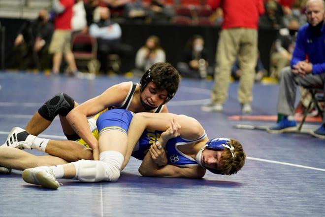 New London's Marcel Lopez (top) works to turn Don Bosco's Garrett Funk in a Class 1A semifinal match Friday at Wells Fargo Arena in Des Moines.