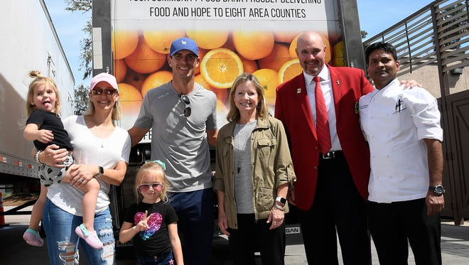 PGA Tour Player Billy Horschel helped The Players Championship load a huge donation of food to Feeding Northeast Florida on March 13, 2020, the same day The Players was canceled. From the left are Horschel's daughter Colbie, his wife Brittany, his daughter Skylar, Horschel, Feeding Northeast Florida CEO Susan King, Players 2020 chairman Andy Carroll and TPC Sawgrass senior executive chef Azhar Mohammad (Photo by Chris Condon/PGA TOUR)