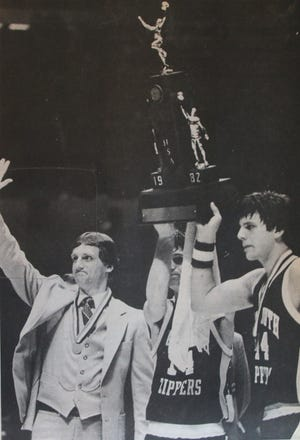 Coach Mike Mueller (left) and future NBA coach Mike Miller (right) are pictured with the state runner-up trophy. In the middle is Mel Blasi, a future NCAA Division I head coach. [SUBMITTED PHOTO]