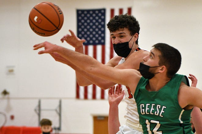 United's Declan Flynn and Wethersfield's Kale Nelson battle for a rebound during Friday night's game at United.