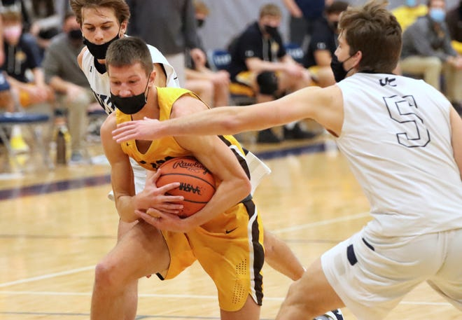 Zeeland East's Trip Riemersma protects the ball against Unity Christian.