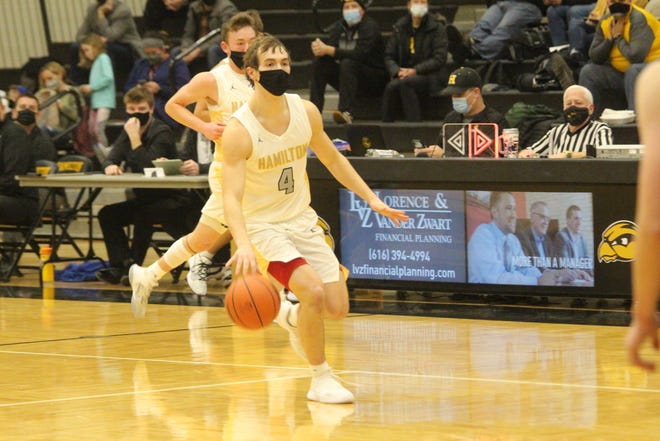 Hamilton's Logan Zoerhof dribbles up the court in their loss to Spring Lake on Friday, Feb 19, 2021