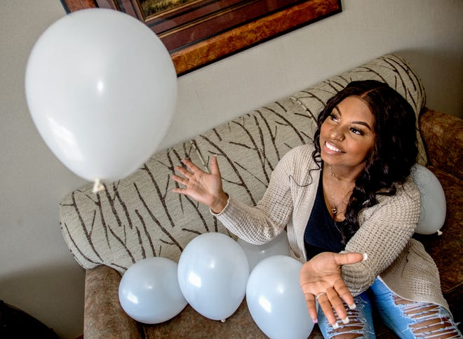 Shatiya Alexander, 23, owns and operates BlownAway Balloons, a Peoria business that provides elaborate balloon towers, arches and other creations for events like weddings and birthday parties throughout central Illinois.
