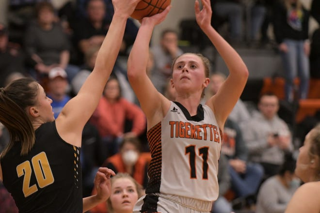 Macon's Brooke Weimer pulls up for a jumper Friday against Monroe City.