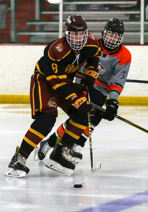 Stow-Munroe Falls' Reece Hricik skates the puck ahead during the Bulldogs' 6-5 loss to Chagrin Falls Friday at The Pond at Auburn.