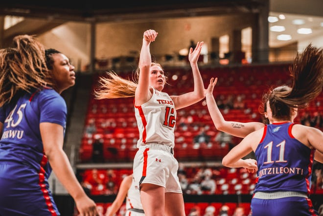 Texas Tech's Vivian Gray attempts a shot during a Big 12 Conference game Saturday against Kansas at United Supermarkets Arena. Gray finished with a career-best 38 points and 10 rebounds in 43 minutes to help the Lady Raiders win 99-98.