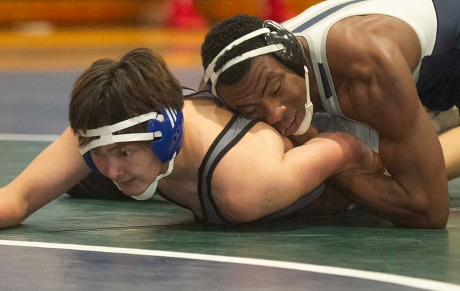 McKeel Academy's Wayne Campbell, right, wrestles with Mulberry High School's David Sineath during their 160-pound championship match at the FHSAA Class 1A, District 11 wrestling tournament at McKeel Academy in Lakeland Friday night. Campbell won the match.