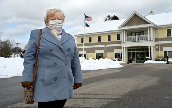 Natick resident Kathy Uek, 75, stands outside the Natick Community-Senior Center, Feb. 20, 2021, where she received her COVID-19 vaccination earlier last week. At the same site, when it was the Lincoln School, Uek received her polio vaccination in 1955.