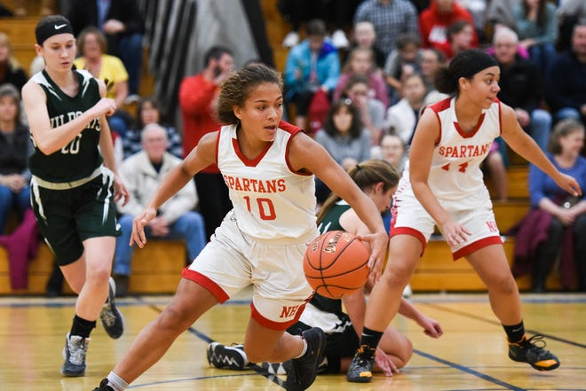 New Hartford and Adirondack participate in a Dec. 2019 basketball game. Both schools are among those that have been given approval by Oneida County to participate in high-risk sports during the winter season