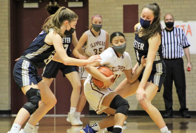 Exeter's Emma Smith (10) and Christina Snicer (1) surround Portsmouth's Rosayla Gonzalez (10) during the second quarter of Friday's Division I girls basketball game in Portsmouth.