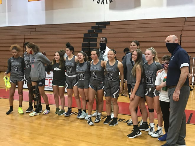 The American Heritage girls basketball team poses for a photo after winning its Region 4-4A final over Monsignor Edward Pace on Friday, Feb. 19, 2021, in Miami Gardens.