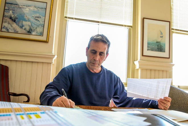 Warwick's new mayor, Frank Picozzi , catches up on paperwork Saturday at City Hall.