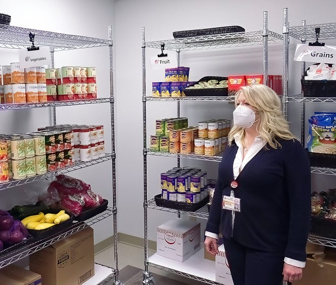 Director of Food and Nutrition/Clinical Nutrition Manager at University Hospitals-Sodexo Lynann Colella leads a tour of the Food for Life Market at UH Portage Medical Center, which includes a variety of canned goods, as well as produce, meat and dairy products.