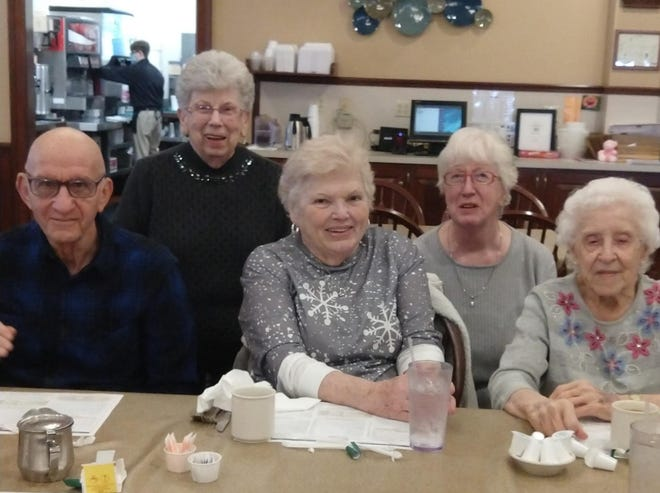 Celebrating Lois Snively's birthday at Hartville Kitchen are, from left, Al Pennock, Patti Andrews, Carol Pennock, Corky Farquhar and Snively.