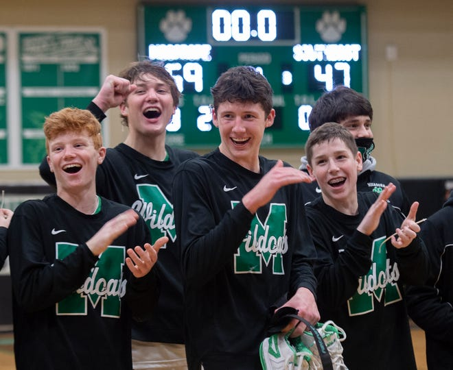 Mogadore defeats Southeast 59-47 for the Portage Trail Conference championship. The Wildcats cut down nets after their win.
