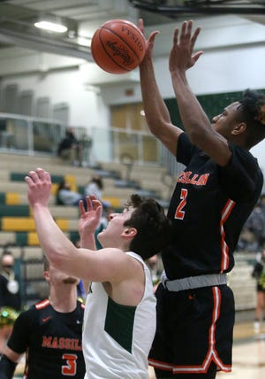 Massillon's Ardell Banks goes up for a rebound during the Tigers' regular-season finale at GlenOak.
