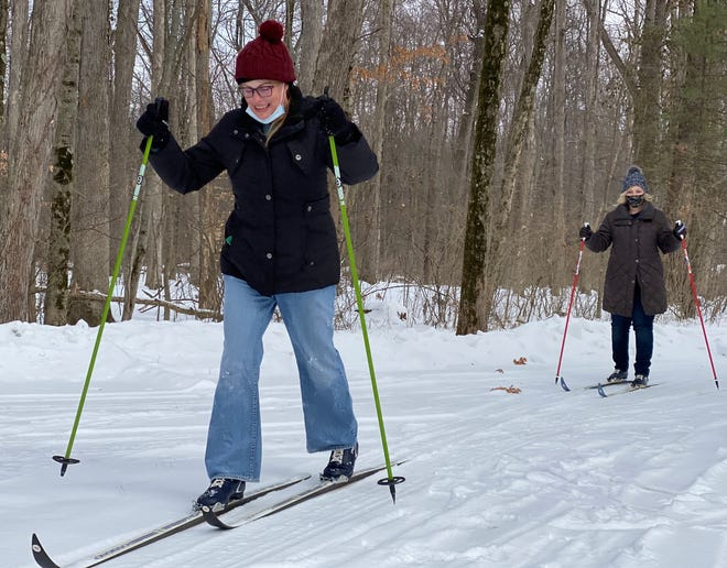 Debbie McMillan, front, and Wendy Clark, cross-country ski on Saturday at Quail Hollow State Park. Stark Parks offers equipment rentals and instructions this winter on certain dates weather permitting.