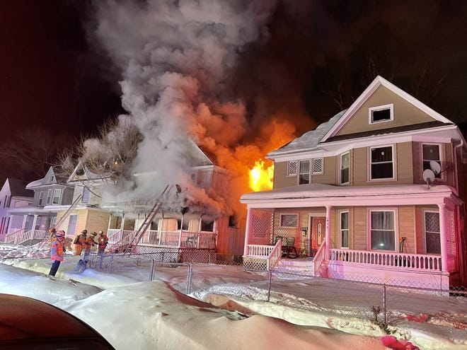 The house at 939 N. Court St. in Rockford was damaged by fire on Saturday, Feb. 20, 2021. The flames spread to the house directly to the north. No one was injured.
