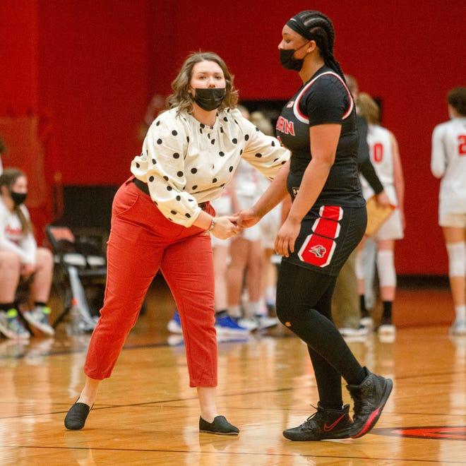 Auburn's Brooklyn Gray talks to coach Taylor Griffin on Thursday, Feb. 18, 2021, at Harlem High School.