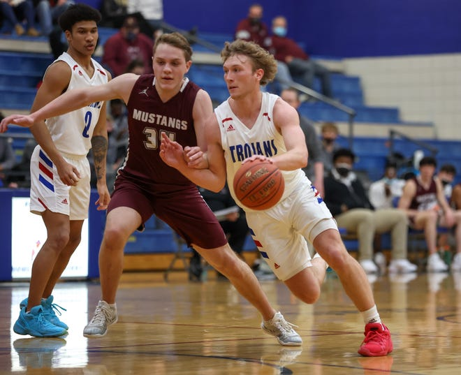 Andover guard Jack Johnson drives to the basket against Salina Central's Reed McHenry (34) on Thursday night at the Andover Middle School gym. Johnson finished with a school-record 41 points in leading the Trojans to an 80-66 victory, while McHenry had 27 for Central.