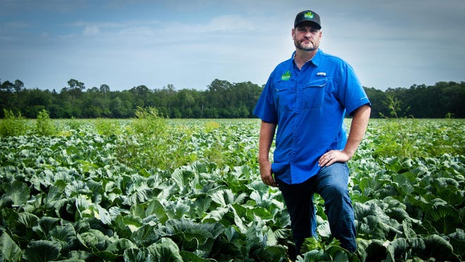 Chris Barnes stands in one of his fields in April 2020. Barnes, 43, died following a sudden medical event at his home Feb. 15, according to his family.