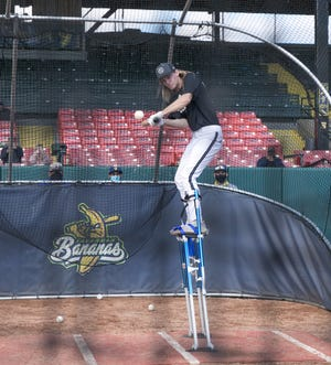 Dakota Albritton, from Schley County, takes batting practice while wearing stilts during tryouts for the Savannah Bananas Premier Team on Saturday at Grayson Stadium. [RANDY THOMPSON/SAVANNAHNOW.COM]