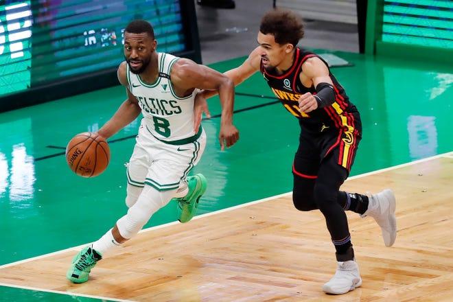 Boston Celtics' Kemba Walker (8) drives past Atlanta Hawks' Trae Young (11) during the Celtics' 121-109 win Friday in Boston.
