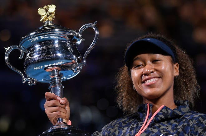 Japan's Naomi Osaka holds the Daphne Akhurst Memorial Cup after defeating United States Jennifer Brady in the women's singles final at the Australian Open.