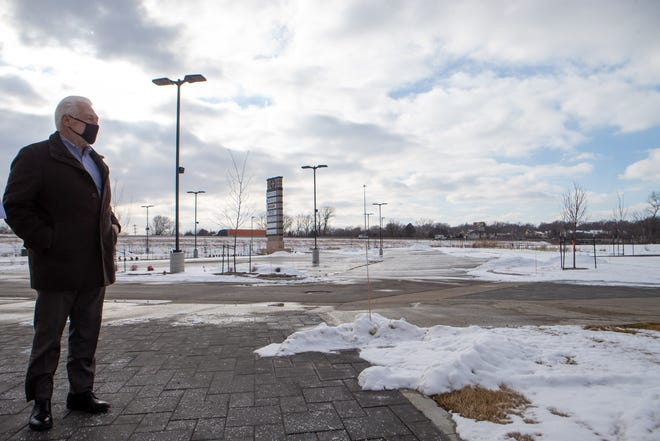 Looking out over the empty lot Wednesday afternoon where an apartment complex will soon be constructed, Jim Klausman, co-developer of Wheatfield Village, envisions the mixed-use development's final form being a vibrant, walkable community.