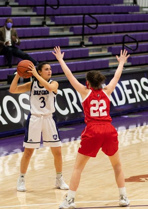 Holy Cross guard Avery LaBarbera big effort Sunday helped the Crusaders defeat BU on the road.