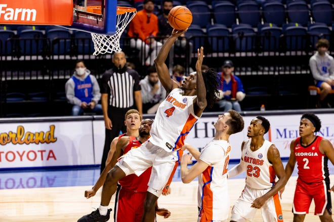 Florida forward Anthony Duruji makes a fade-away layup Saturday against Georgia at Exactech Arena.