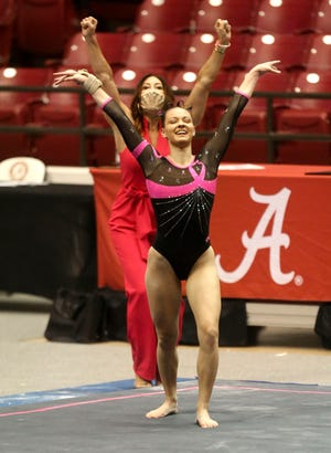 Coach Dana Duckworth reacts as Shallon Olsen lands her tumbling run in the Power of Pink meet against LSU Friday, Feb. 19, 2021, in Coleman Coliseum. The Crimson Tide defeated LSU 197.725 to 197.325. [Staff Photo/Gary Cosby Jr.]