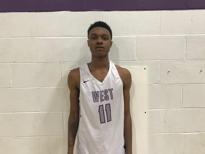 Cherry Hill West junior Justin Smith scored a game-high 17 points as the Lions upset Cherry Hill East 43-40 on Friday night.