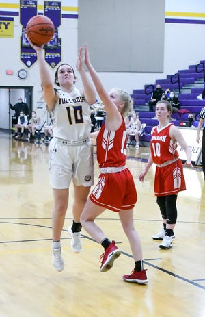 Bloom Carroll senior Carley Bryant attempts a shot during the first half against London Friday night at Tom Petty Gymnasium. The visiting Red Raiders prevailed 47-35. -Jamie Potts/Lancaster Eagle Gazette