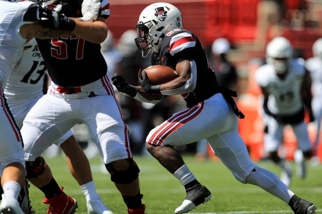 Sep 19, 2020; Cincinnati, Ohio, USA; Austin Peay Governors running back CJ Evans Jr. (23) carries the ball against the Cincinnati Bearcats in the first half at Nippert Stadium. Mandatory Credit: Aaron Doster-USA TODAY Sports