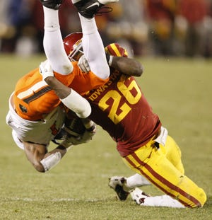 Second-ranked Oklahoma State was upended by defensive back Deon Broomfield and Iowa State in 2011. Register file photo Iowa State's Deon Broomfield upends Oklahoma State's Joseph Randle for a short gain late in the fourth quarter during their game at Jack Trice Stadium in Ames Friday Nov. 18, 2011. (Photo by Justin Hayworth/The Des Moines Register)