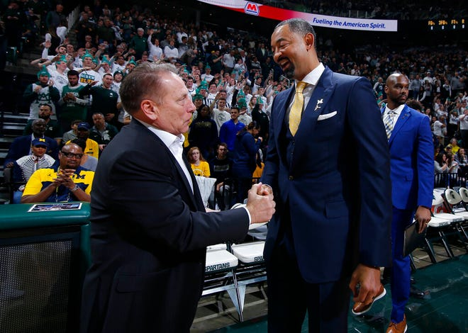 Michigan State coach Tom Izzo, left, and Michigan coach Juwan Howard greet each other before a game Jan. 5, 2020, in East Lansing, Mich. Michigan State won 87-69.