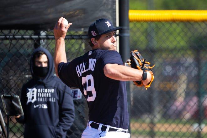 Pitcher Derek Holland throws in the bullpen.