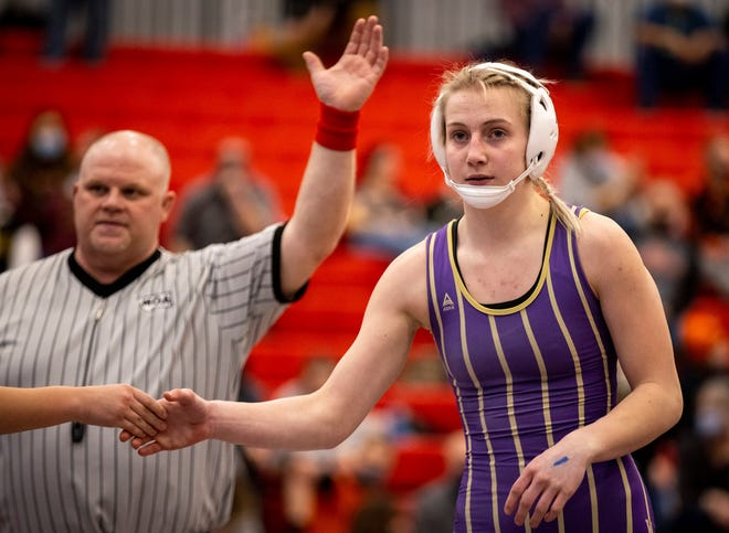 Cut Bank's Mariah Wahl shakes hands after winning her match against Kalispell Glacier's Kayla Peterson during the first day of the MHSA Girl's Wrestling State Tournament at Lockwood High School Friday.