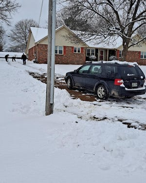 Jackson Fire Department personnel helped shovel this driveway so the homeowner could take his wife to dialysis the next day.