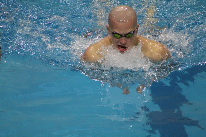 Lexington's Ben Starling competes in the 200 IM at the Division II Northwest District on Friday at Bowling Green State University's Samuel M. Cooper Natatorium.