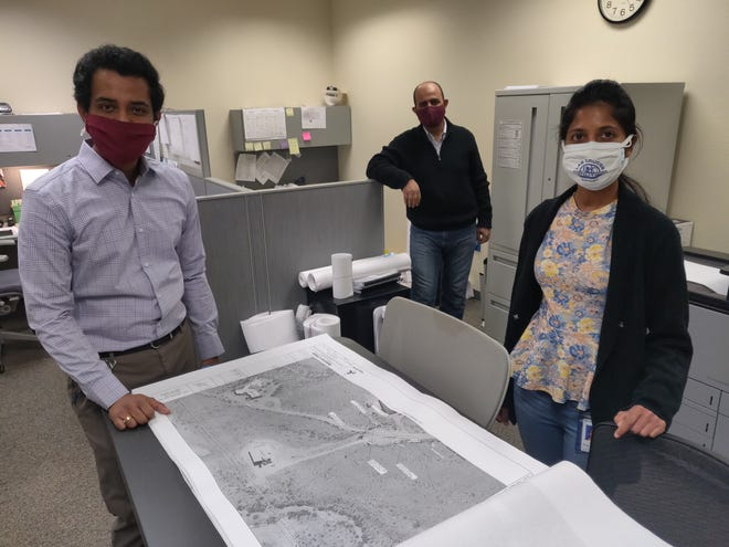From left to right: Las Cruces Utilities Intern Isuru Abeysiriwardana, LCU Senior Engineer Waleed Abu-Issa, and Intern Himali Delanka-Pedige go over blueprints for the design phase of an ongoing LCU project. Delanka-Pedige is adding to her resume by seeing different real-world utility projects happening in Las Cruces.