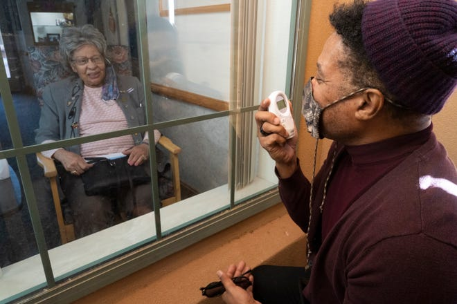 Rio Hamilton chats with his mother at the nursing home where she was placed, against her will. Because of COVID-19 restrictions, this is his only means of visiting her.