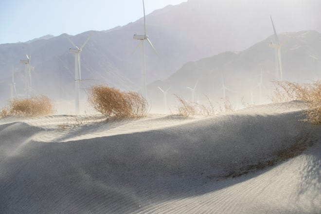 High winds blow sand near North Indian Canyon Drive in Palm Springs, Calif., on February 20, 2021.
