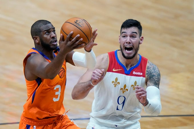 Phoenix Suns guard Chris Paul (3) drives to the basket against New Orleans Pelicans center Willy Hernangomez (9) during the second half of an NBA basketball game in New Orleans, Friday, Feb. 19, 2021. (AP Photo/Gerald Herbert).