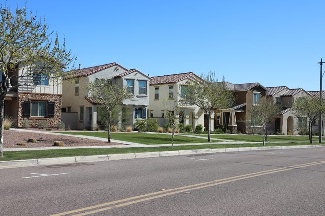 """A row of houses in Verrado, a giant master-planned community referred to as a """"self-contained hometown"""" on Feb. 19, 2021, in Buckeye, Ariz."""