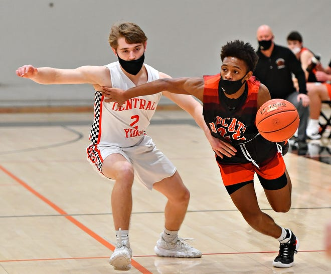Northeastern's Karron Mallory, right, moves the ball down the court while Central York's Cole Luckenbaugh defends during YAIAA boys' basketball action at Central York High School in Springettsbury Township, Friday, Feb. 19, 2021. Northeastern would win the game 71-68. Dawn J. Sagert photo