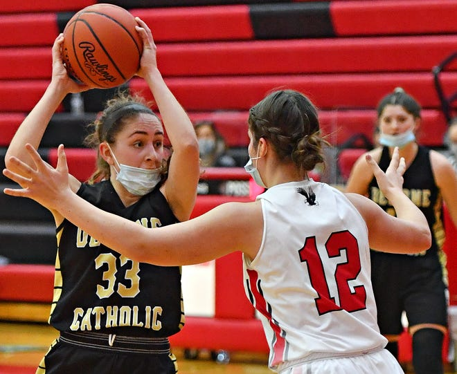 Delone Catholic's Makenna Mummert, left, works to get around Cumberland Valley's Abbie Miller during girls' basketball action at Cumberland Valley High School in Mechanicsburg, Saturday, Feb. 20, 2021. Cumberland Valley would win the game 65-42. Dawn J. Sagert photo