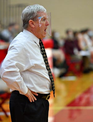Delone Catholic Head Coach Gerry Eckenrode during girls' basketball action at Cumberland Valley High School in Mechanicsburg, Saturday, Feb. 20, 2021. Cumberland Valley would win the game 65-42. Dawn J. Sagert photo